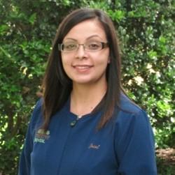 registered dental assistant for crabtree dental jesel in front of a bush