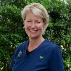 registered dental hygienist for crabtree dental sue in front of a bush