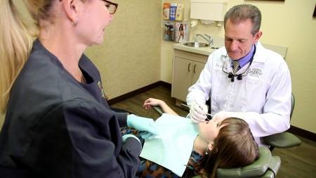 dr-performing-composite-dental-filling