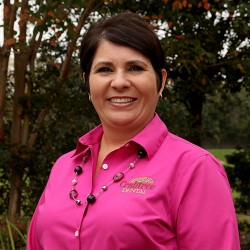 treatment and financial coordinator Charisse is smiling and standing in front of trees at crabtree dental in katy texas