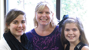Melissa Chicoria and her daughters providing a testimonial